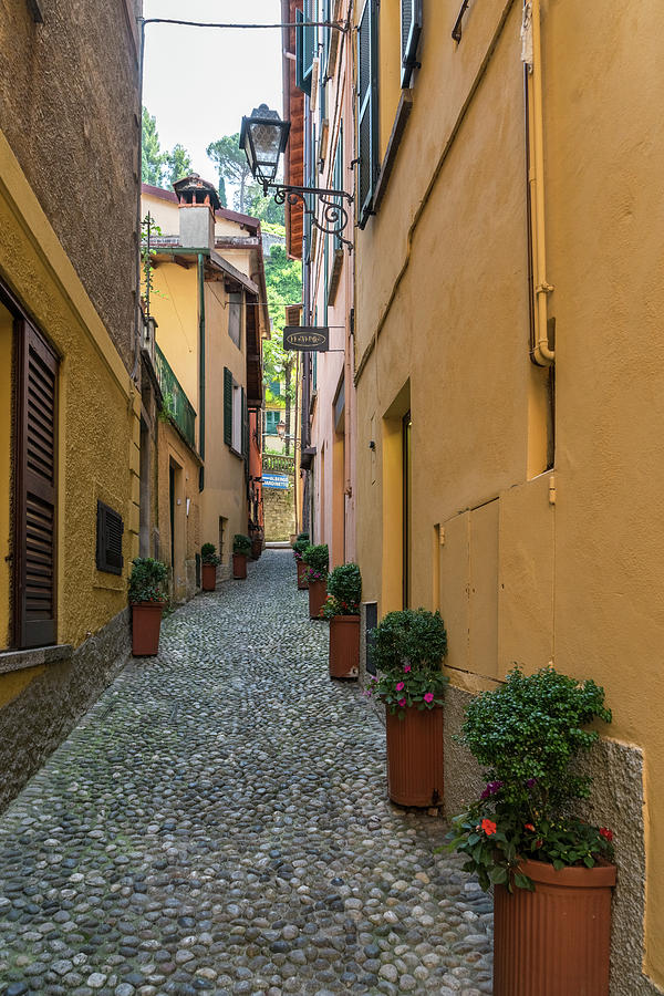 Ocher Yellow Houses Lined with Flowerpots - Gallivanting Around Famous Bellagio on Lake Como in Lomb by Georgia Mizuleva