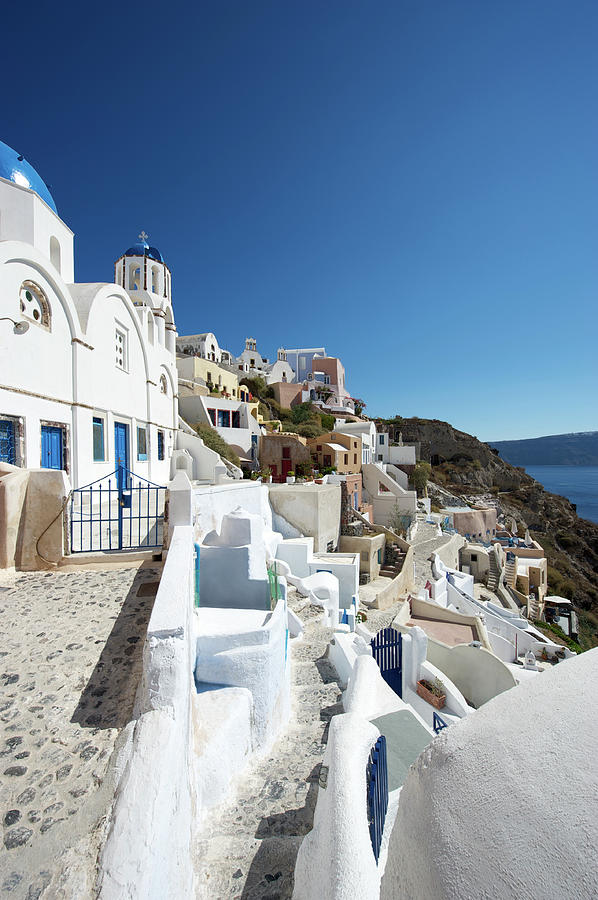 Oia Hillside Village Santorini Blue Sky Photograph by Peskymonkey