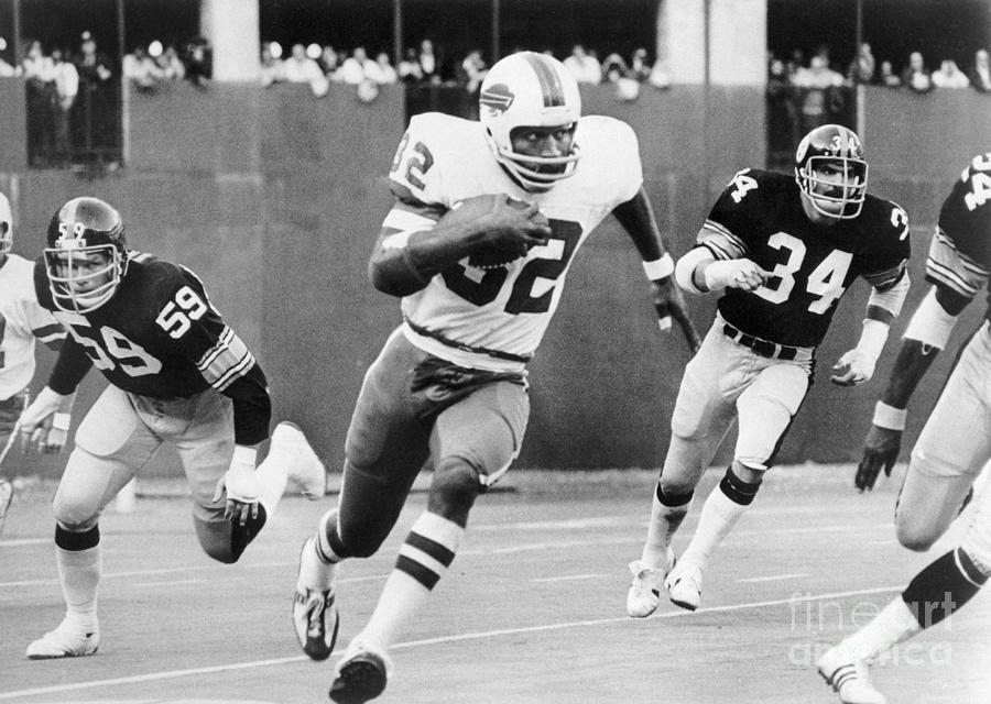 O.j. Simpson Running With Football Photograph by Bettmann