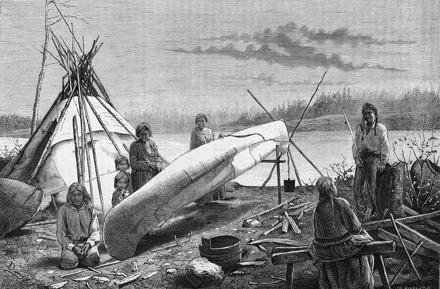 Ojibwe Repairing A Canoe Photograph by Hulton Archive