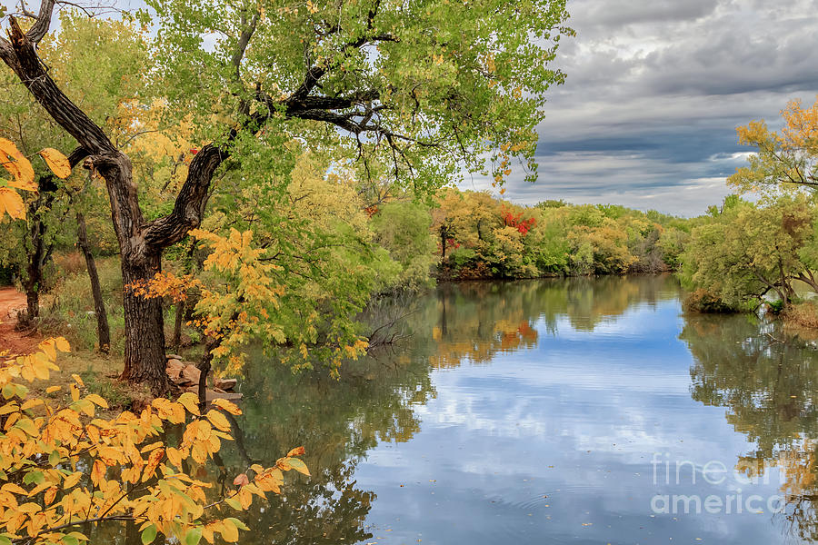 Oklahoma City's Lake Hefner surrounded by trees in fall color by Richard Smith