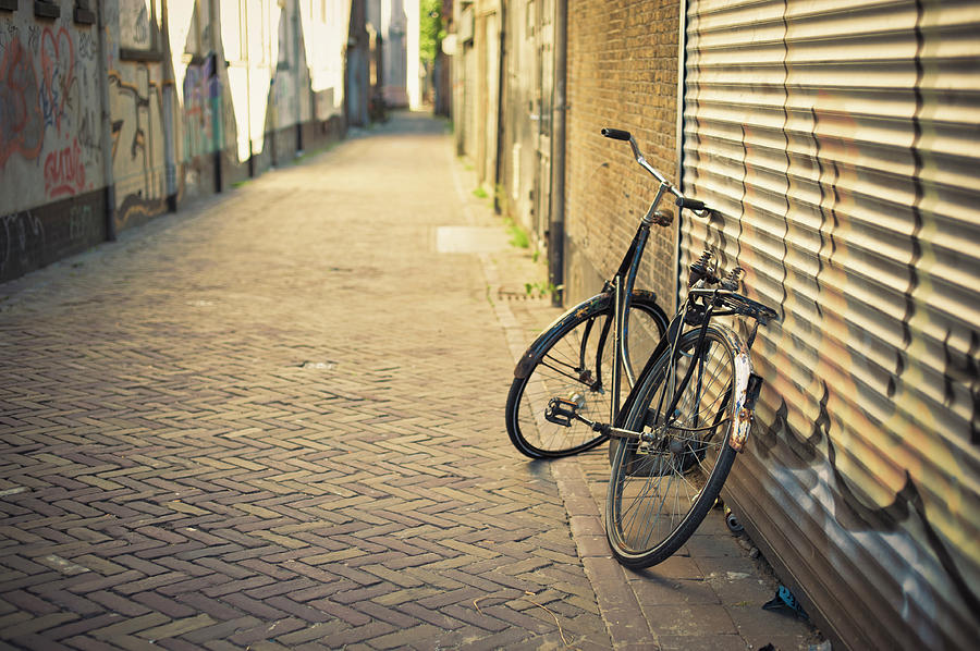 Old Abandoned Bicycle Leaning On The Photograph by Cirano83