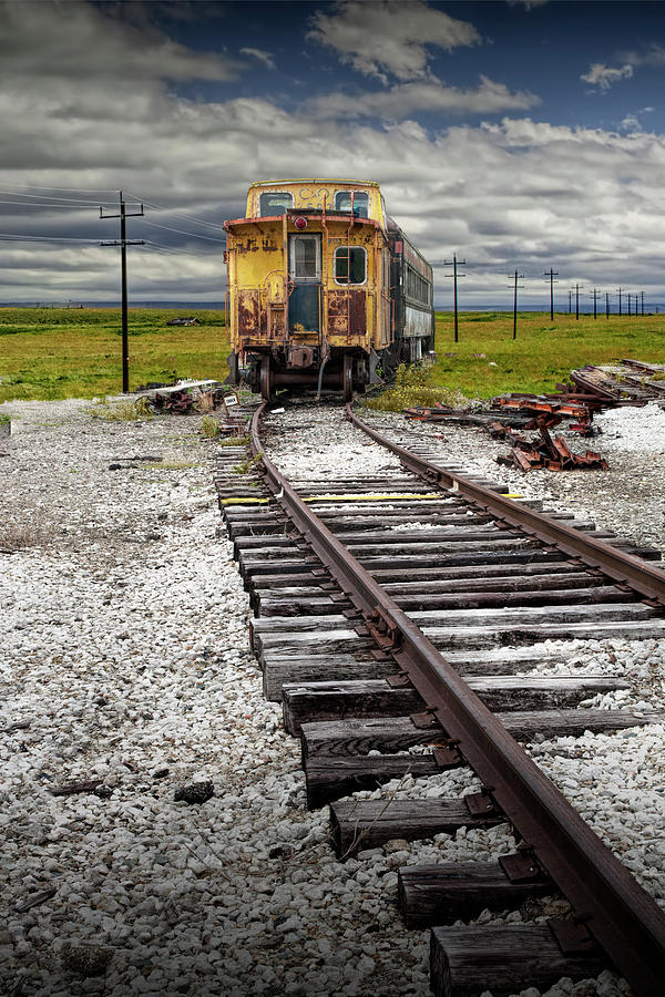 Old abandoned Train Caboose sitting on Train Tracks. by Randall Nyhof
