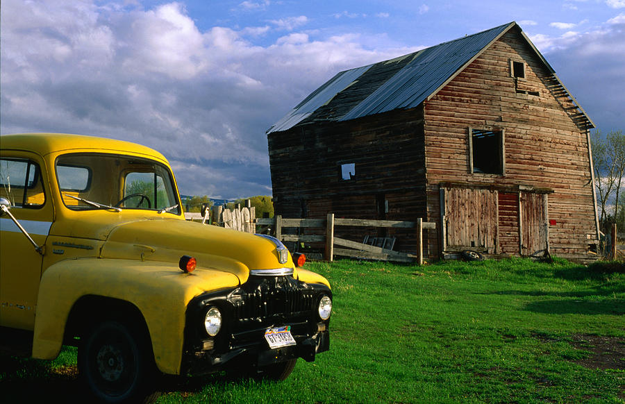 Old Barn And Yellow Pick-up Truck In Photograph by Lonely Planet