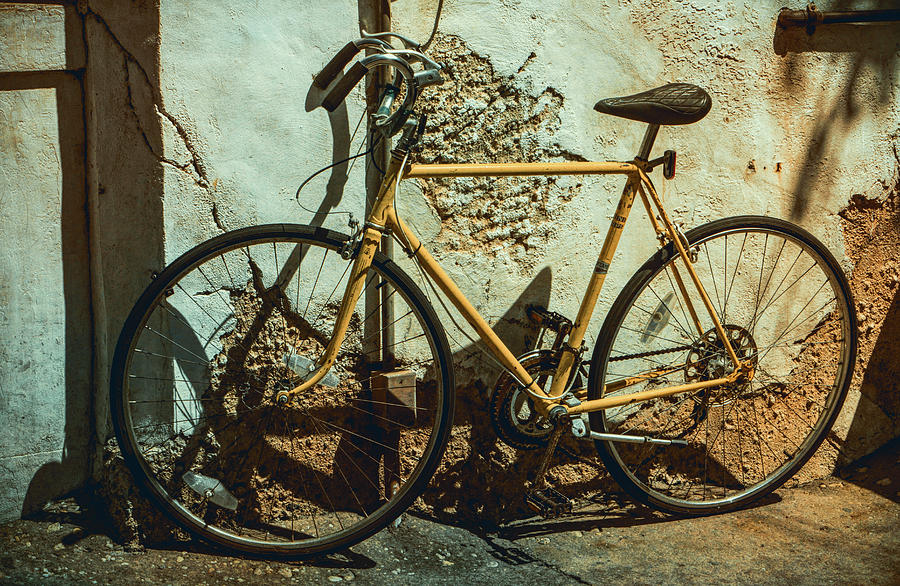 Old Bike Against and Old Wall by Jason Fink