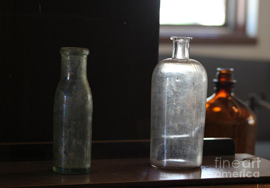 Vintage Bottles Photograph - Old Bottles at Fort Stanton New Mexico by Colleen Cornelius