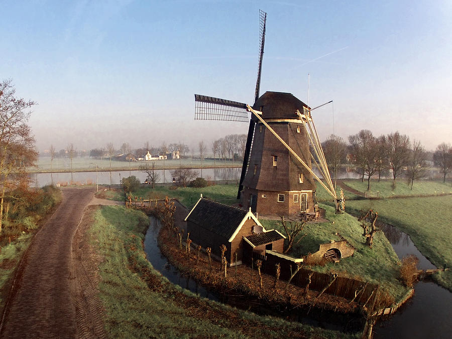 Old Dutch Windmill Near Amsterdam Photograph by Photo By Fabfoto