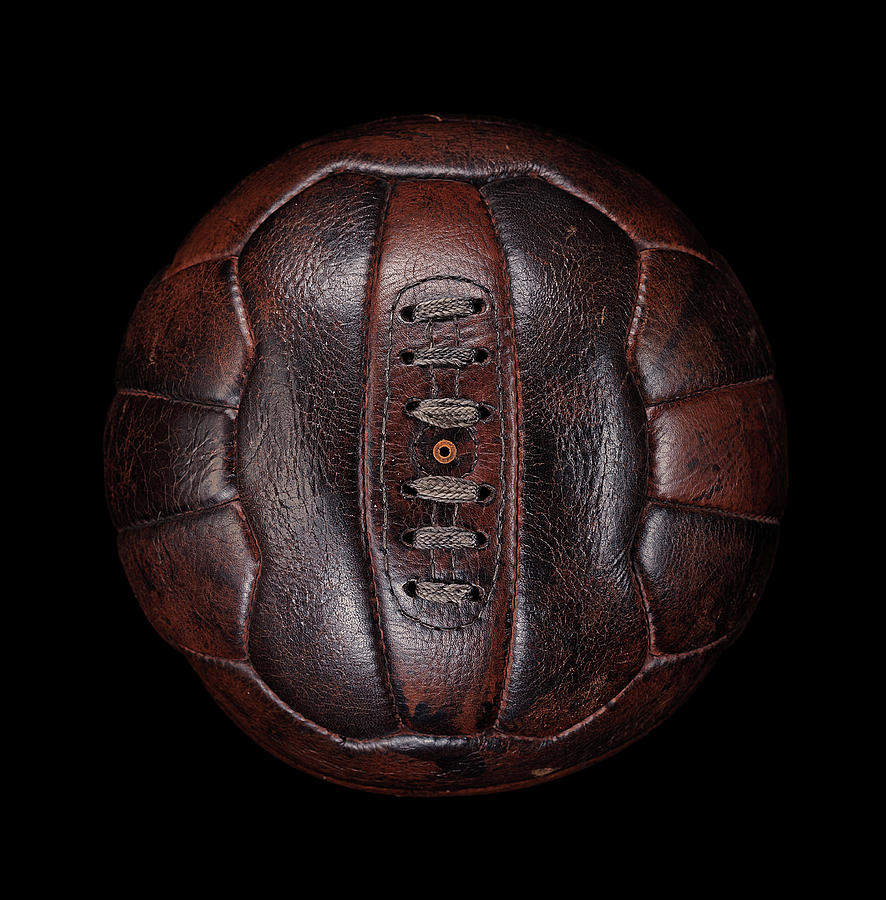 Old Leather Football On Black Photograph by Justin Lambert