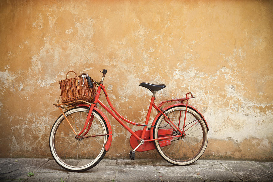 Old Red Bike Against A Yellow Wall In Photograph by Romaoslo