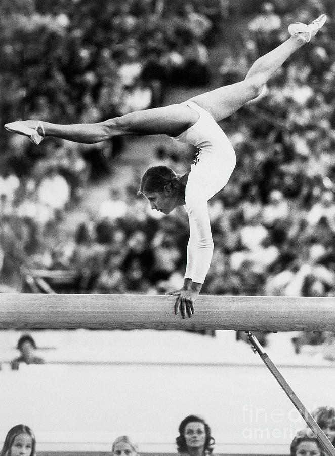 Olga Korbut Performing On Balance Beam Photograph by Bettmann