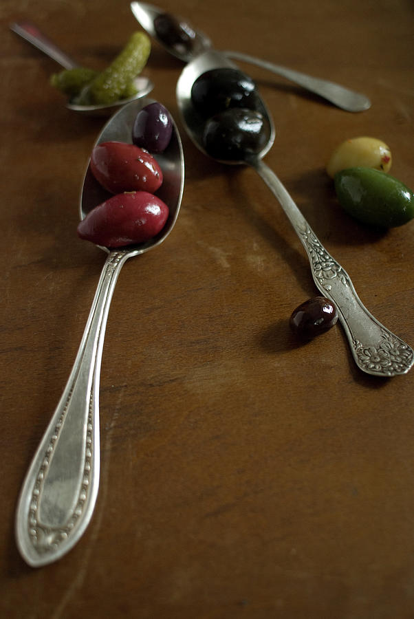 Olives And Spoons Photograph by Melina Hammer