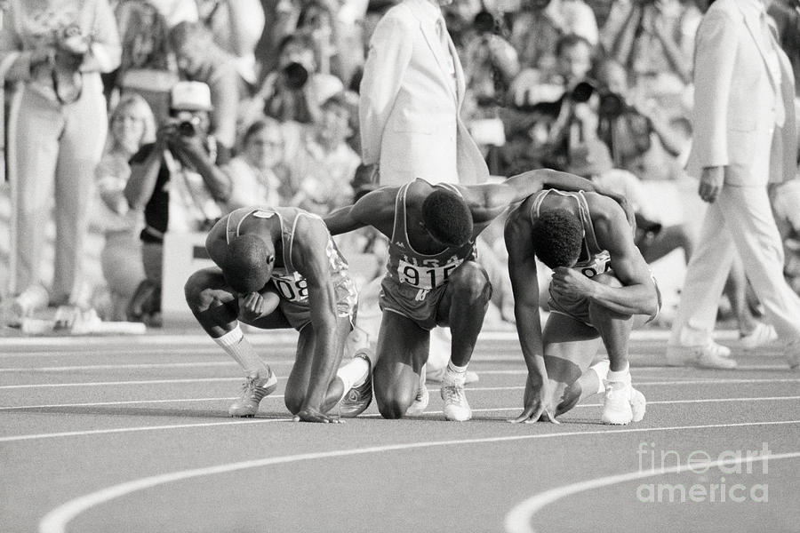 Olympic Medal Winners Pray In Thanks Photograph by Bettmann