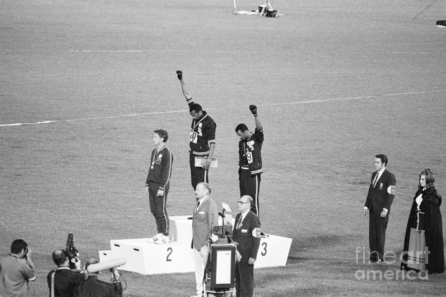 Olympic Medalists Giving Black Power Photograph by Bettmann