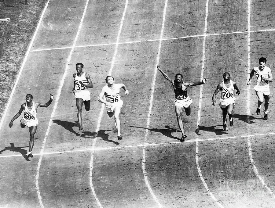Olympic Runners Finishing Dash Photograph by Bettmann