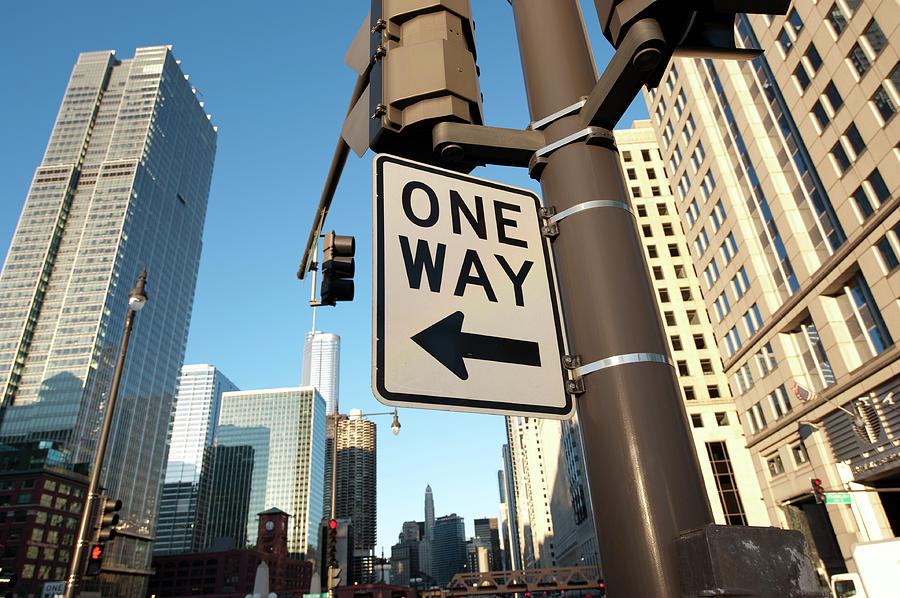 One Way Street Sign In The Downtown Photograph by Thepixelchef