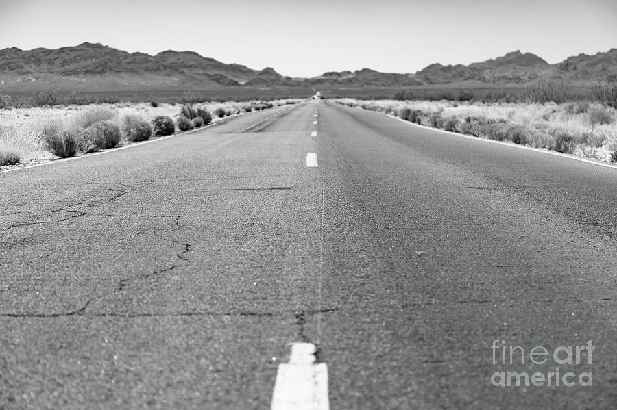 Remote Photograph - Open Stretch Of Road Through The Desert by Edward Fielding