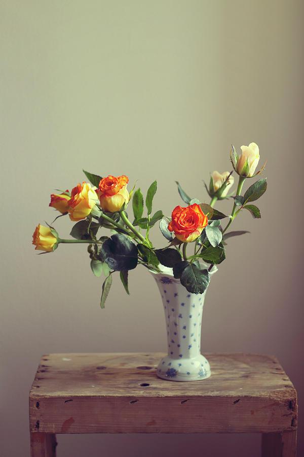 Orange Roses In Vintage Vase Photograph by Copyright Anna Nemoy(xaomena)