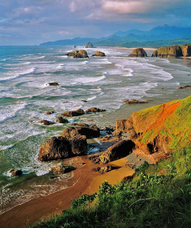 Oregons Stormy And  Rocky Coastline Pg Photograph by Ron thomas