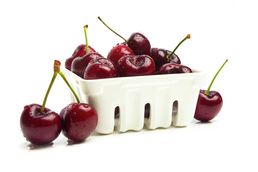 Organic Wet Cherries In Container Photograph by Ryasick