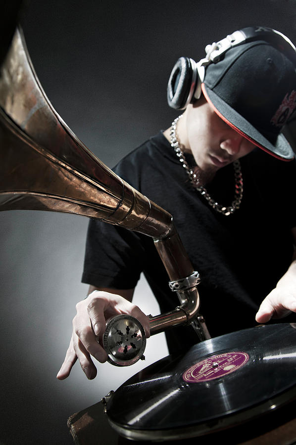 Oriental Dj Using Old Gramophone To Mix Photograph by Justin Lambert
