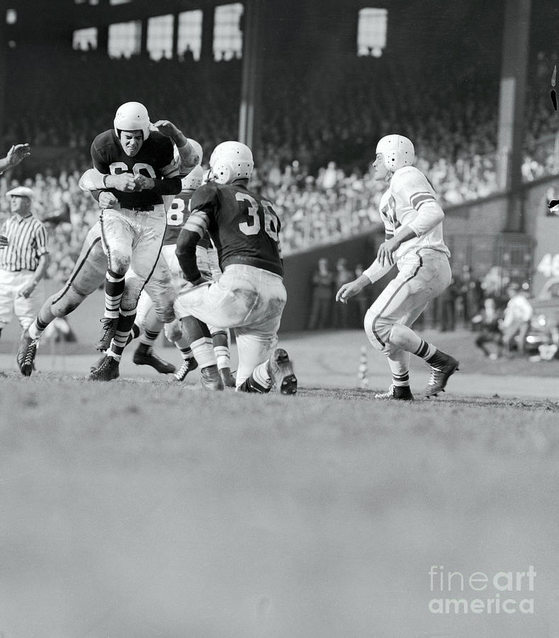 Otto Graham Being Hit During Game Photograph by Bettmann