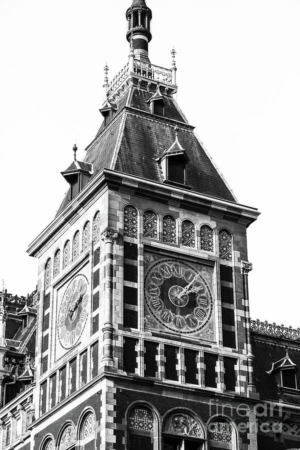 Double Clock at the  Amsterdam Centraal station by John Rizzuto