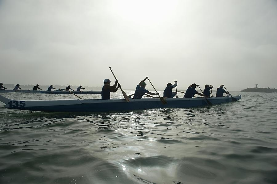 Outrigger Canoeing Team Compete Photograph by Moodboard