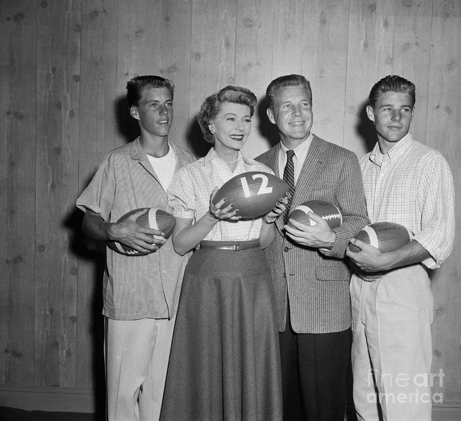 Ozzie Nelson And Family Holding Photograph by Bettmann