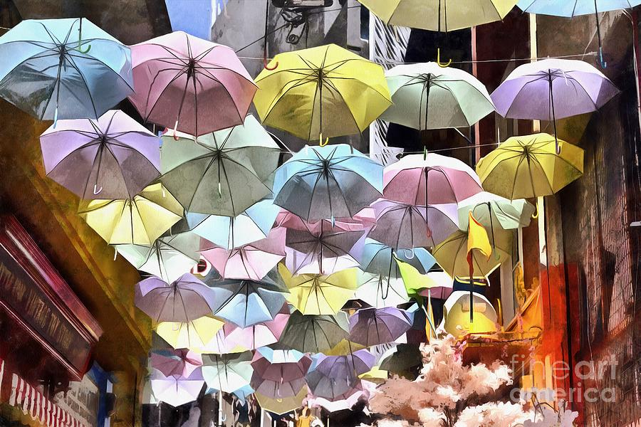 Painting of colorful umbrellas hanging in a street  by George Atsametakis