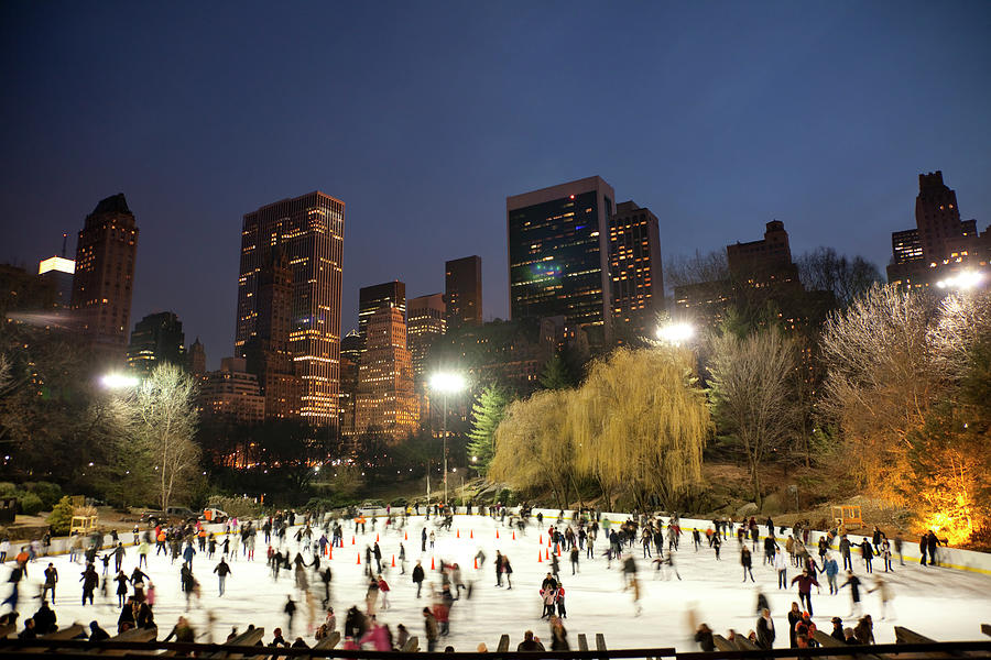 Panorama Of People Ice Skating In Photograph by Studiokiet
