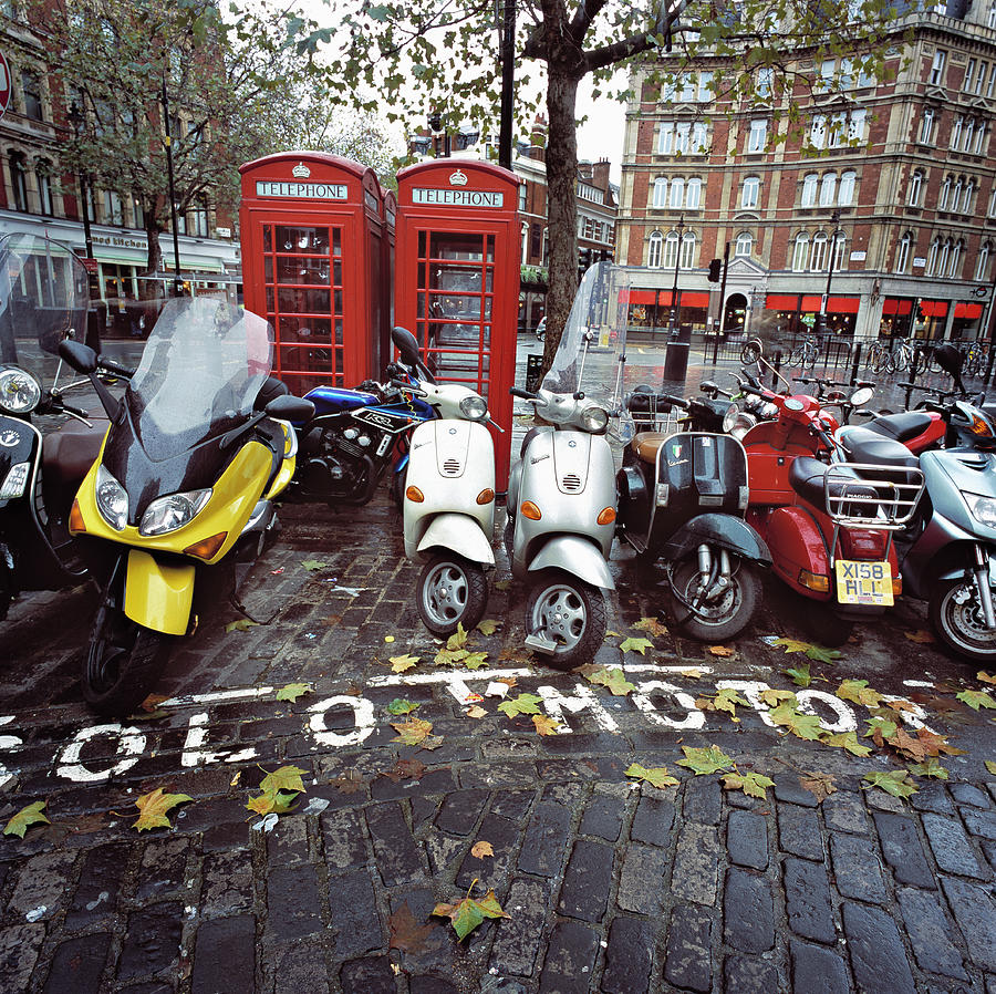 Parked Motorbikes And Scooters By Phone Photograph by Ghislain & Marie David De Lossy