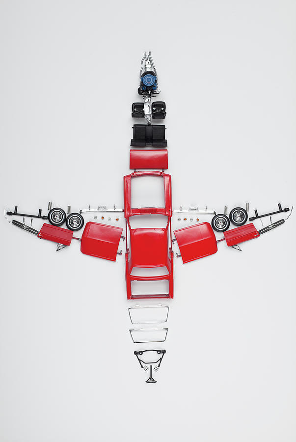 Parts Of A Model Car Arranged In The Photograph by Larry Washburn