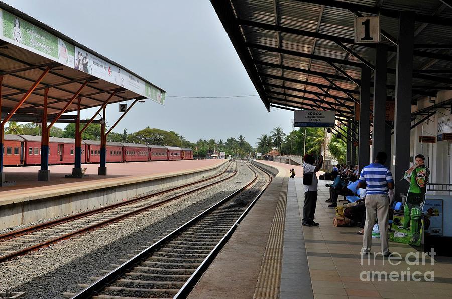 Passengers wait on platform for Colombo bound train at Jaffna Railway Station Sri Lanka by Imran Ahmed