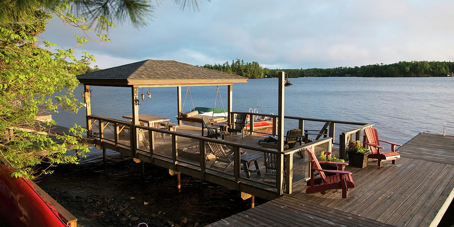 Patio Furniture On A Wooden Dock On A Photograph by Keith Levit / Design Pics