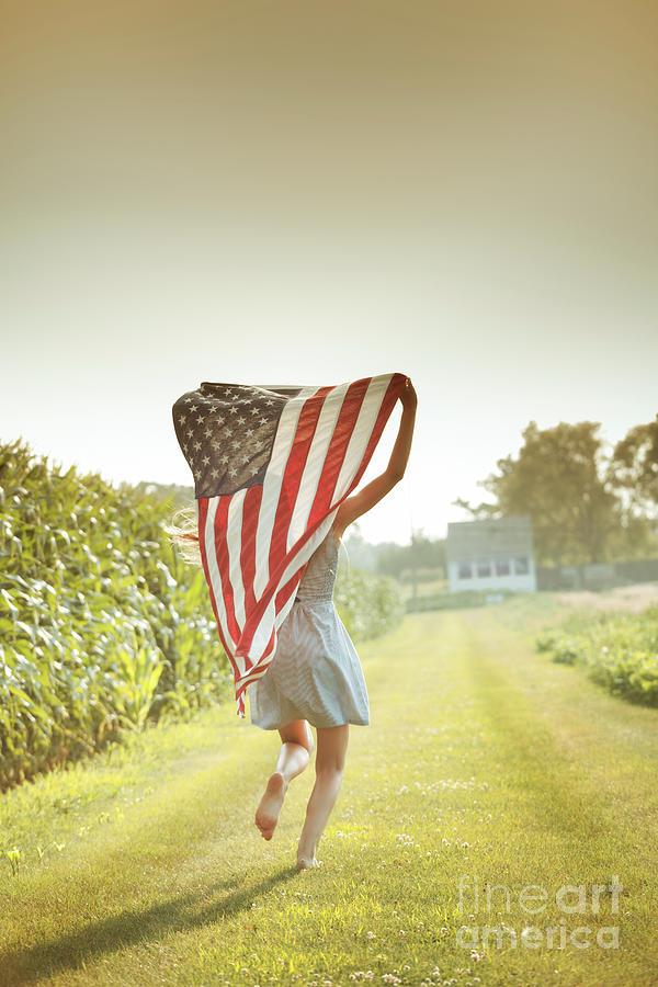 Patriotic Girl Flying American Flag Photograph by Yinyang