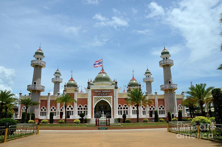 Pattani central mosque courtyard with pond minarets and Thai flag Thailand by Imran Ahmed