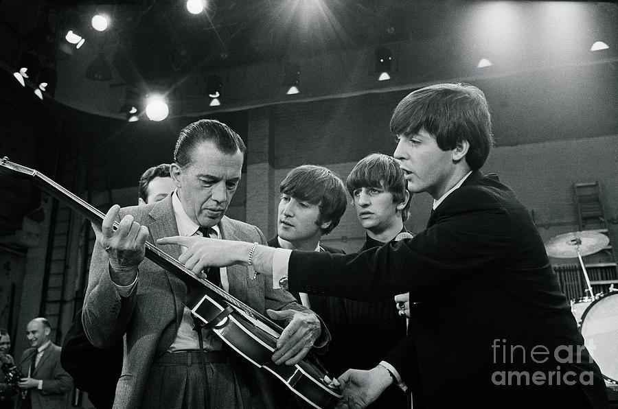 Paul Mccartney Giving Ed Sullivan Photograph by Bettmann