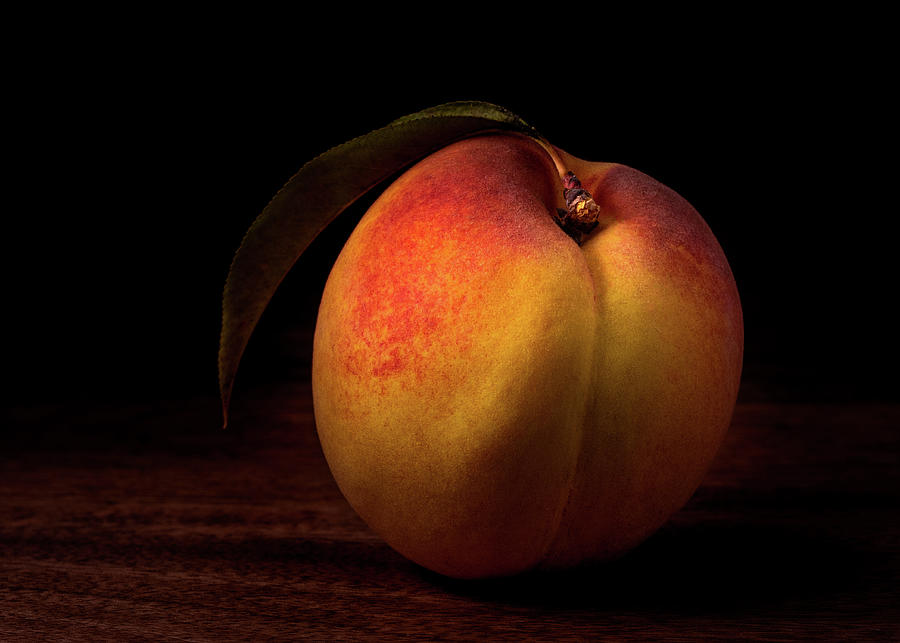Beautiful peach on wooden board by Alessandra RC