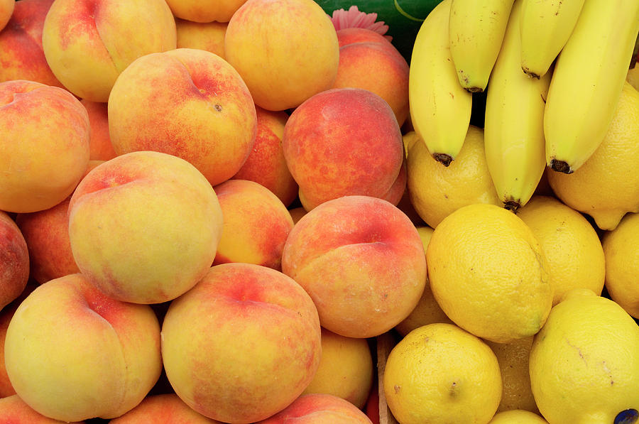 Peaches, Lemons And Bananas At Farmers Photograph by Travelif