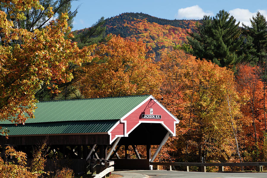 Peak fall colors over the Jackson Covered Bridge by Jeff Folger
