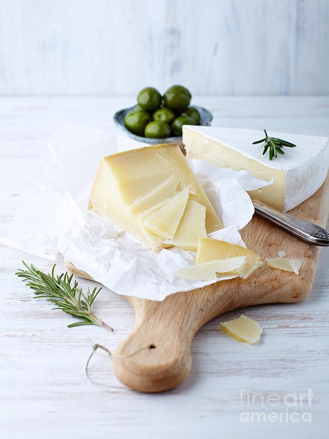Chopping Board Photograph - Pecorino And Brie Cheese On A Kitchen by Barbara Dudzinska