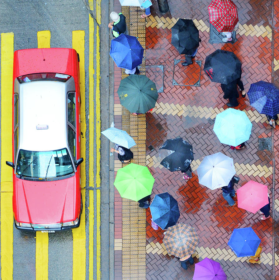 Pedestrians And Hong Kong Street In The Photograph by Olaser