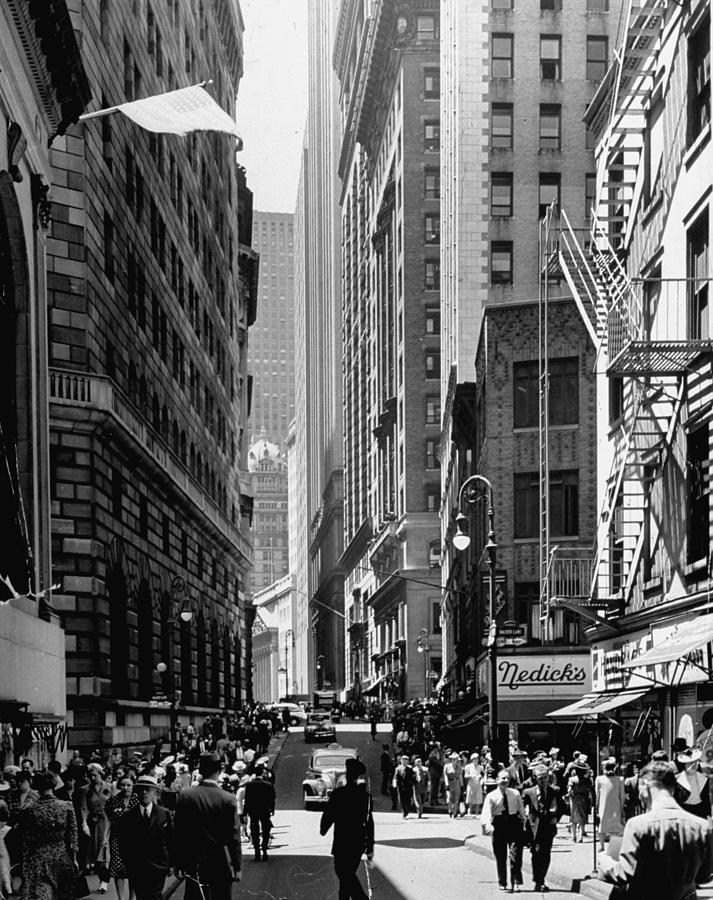 Pedestrians Walking Down Nassau St. Past Photograph by Andreas Feininger