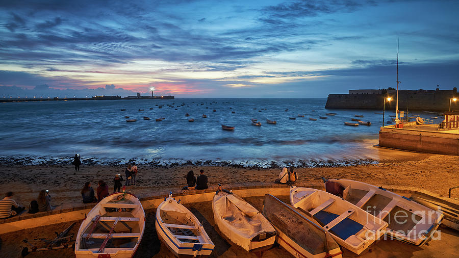 People at Caleta Beach Photographing Sunset Dramatic Sky Cadiz Andalusia Spain by Pablo Avanzini