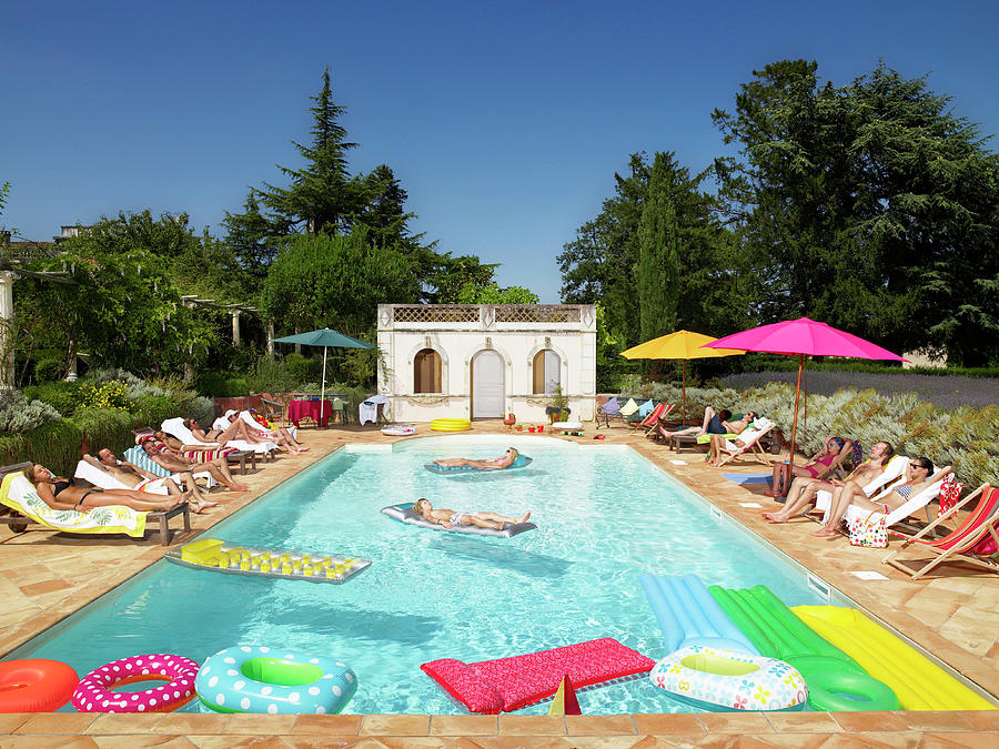 People Enjoying Summer Around The Pool Photograph by Ghislain & Marie David De Lossy