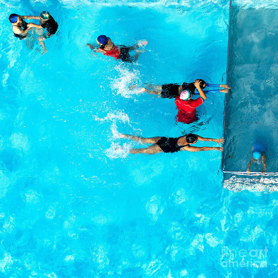 Compete Photograph - People Exercising In A Swimming Pool by Mongpro