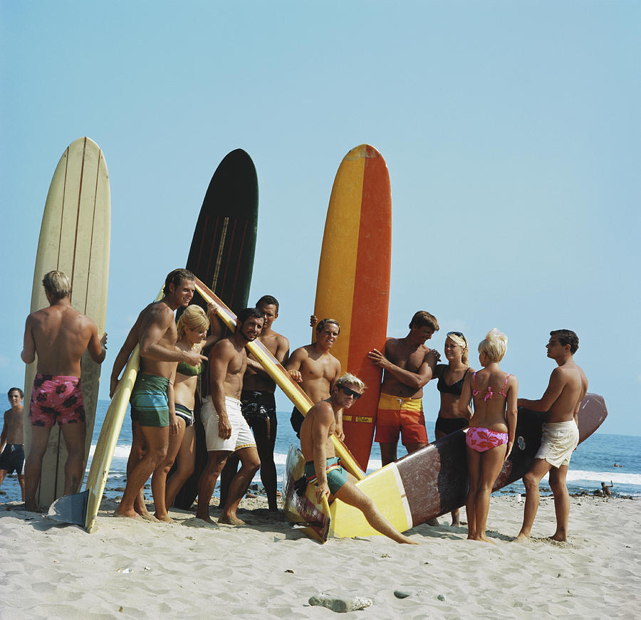 People On Beach With Surf Board Photograph by Tom Kelley Archive