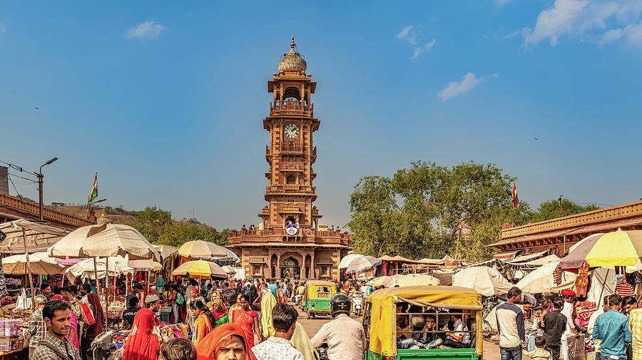 People Photograph - People shopping at market place around clock tower in Jodhpur, R by Marek Poplawski