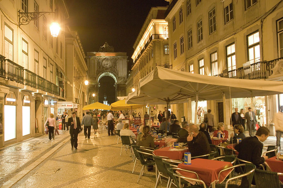 People Sitting Outside Along Rua Photograph by Lonely Planet