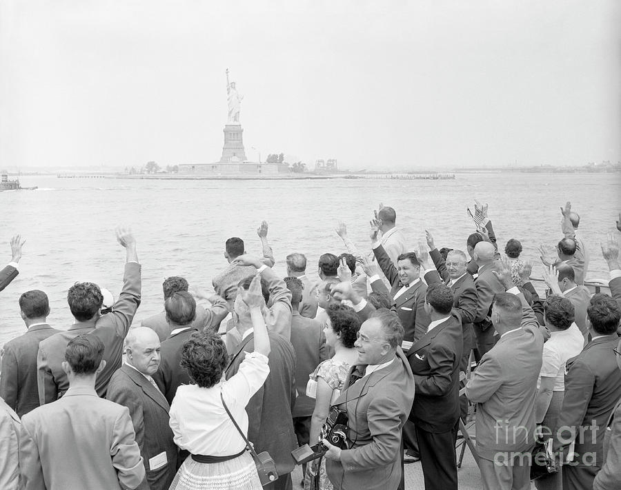 People Waving To The Statue Of Liberty Photograph by Bettmann